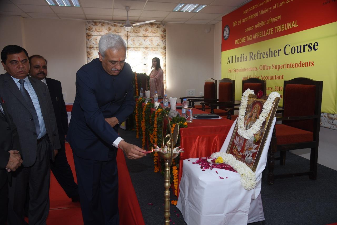 Hon'ble President Justice PP Bhatt lighting the lamp on the occasion. Shri NK Saini, Hon'ble VP (CZ) and Shri Rajeshwar Prasad, Registrar look on.
