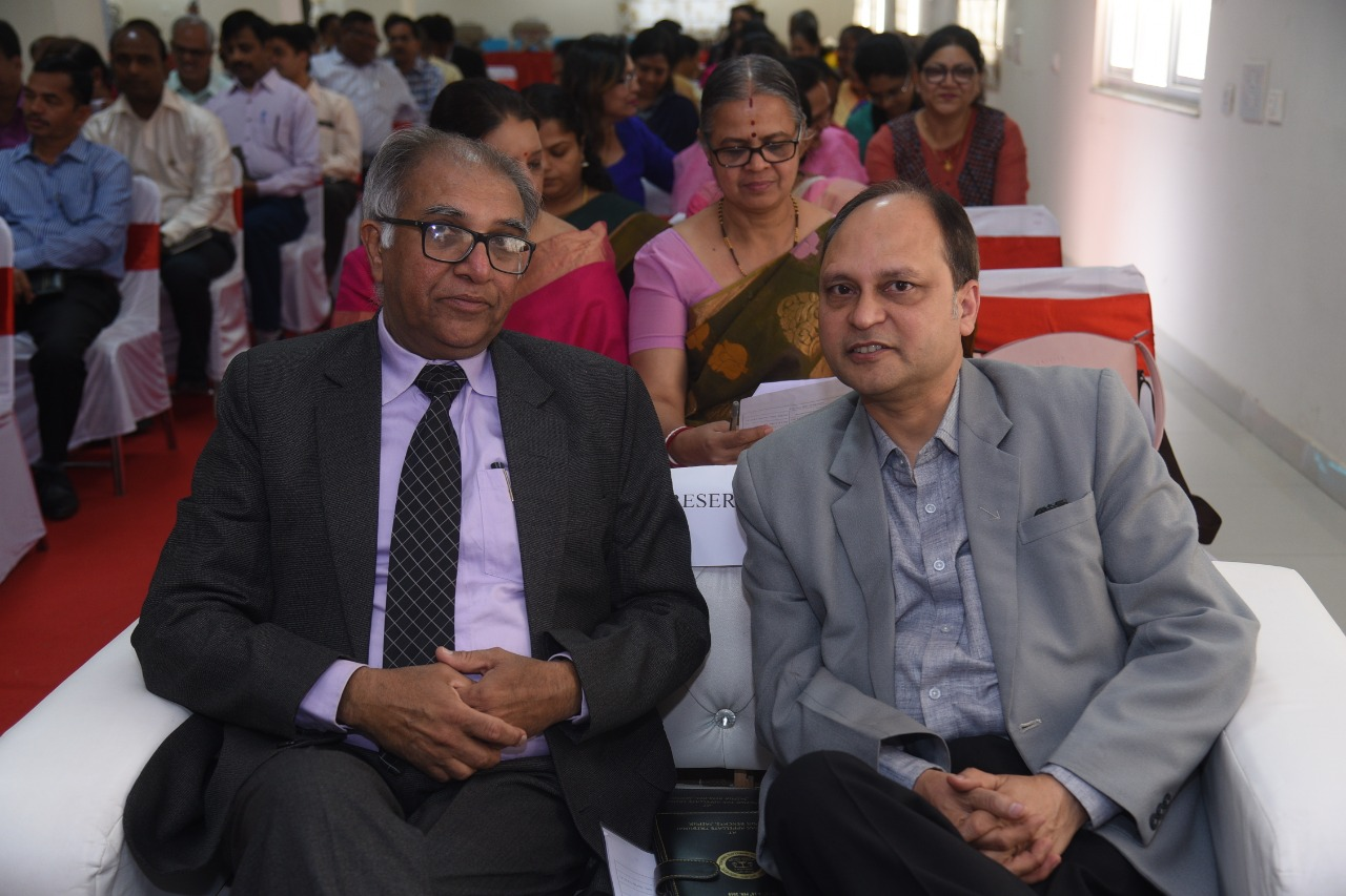 Shri VK Singhal, Deputy Registrar (Central) with a trainer on the occasion
