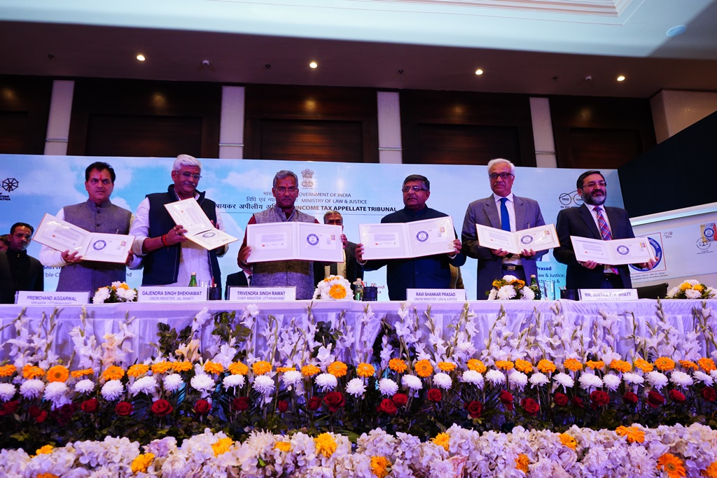 Hon'ble Chief Guest and Hon'ble Guests of Honor releasing Postal Stamp on the occasion
