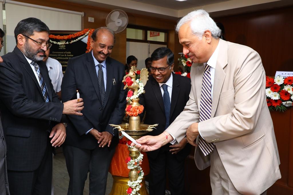 Hon'ble Justice PP Bhatt, President lighting the lamp on the occasion.  Shri NV Vasudevan, Hon'ble Vice President (BZ), Shri GS Pannu, Hon'ble Vice President (DZ) and Shri B R Balakrishnan, Pr. CCIT, Karnataka and Goa look on.